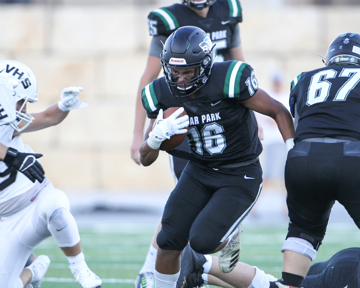 Cedar Park Timberwolves junior running back Jonathan Stockwell (16) carries the ball during a high school football game between the Cedar Park Timberwolves and the Vandegrift Vipers on Friday, Aug. 31, 2018 in Cedar Park, Texas.