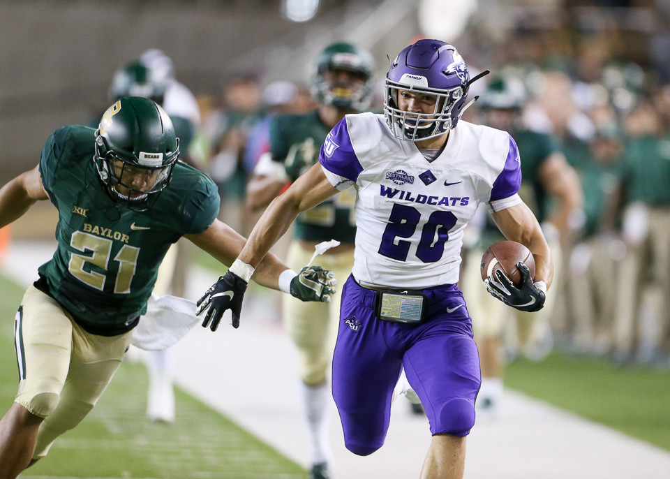Abilene Christian Wildcats running back Billy McCrary (20) outruns Baylor Bears safety Blake Lynch (21) on a 75-yard touchdown run during the first half of an NCAA football game between Baylor University and Abilene Christian University on Saturday, Sept 1, 2018 in Waco, Texas.