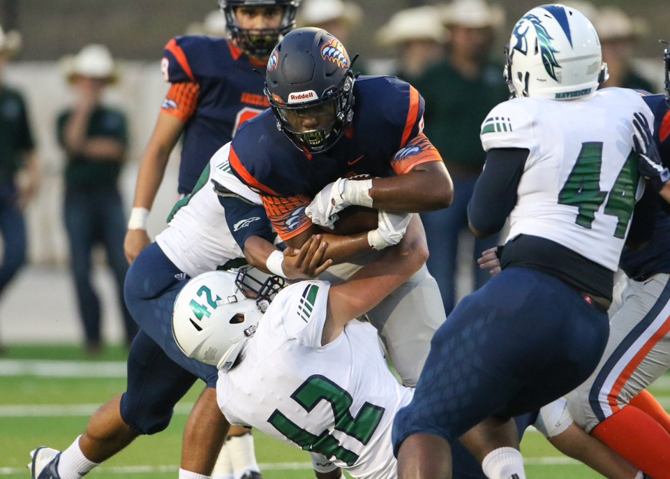 McNeil Mavericks senior defensive end Sammy Latham (42) tackles Glenn Grizzlies junior Julian Morris (21) during a high school football game between Glenn and McNeil on Friday, Sept 7, 2018 in Cedar Park, Texas.