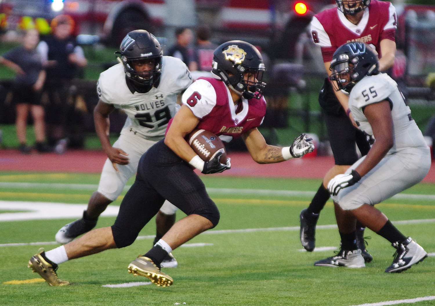 Rouse High School running back Tavian Tate (6) breaks through against Weiss at Bible Stadium on September 13, 2018