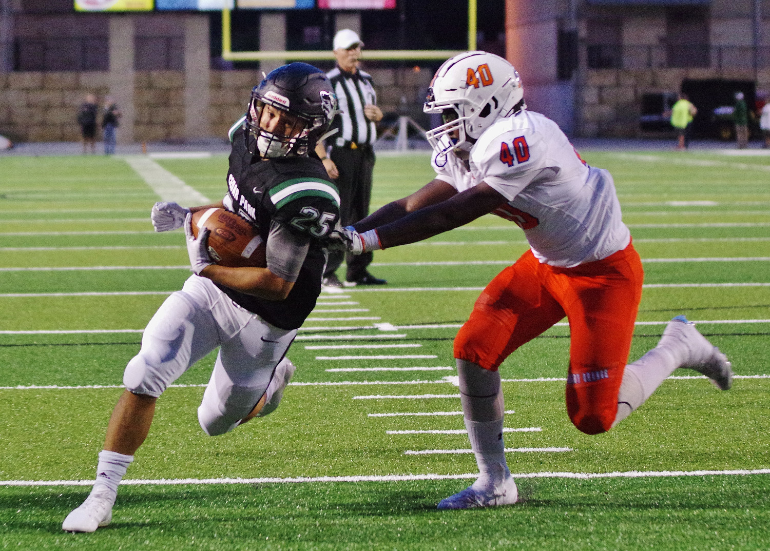 Cedar Park running back Daniel Hernandez (25) runs for a touchdown with seconds left before half-time against San Angelo on September 14, 2018.