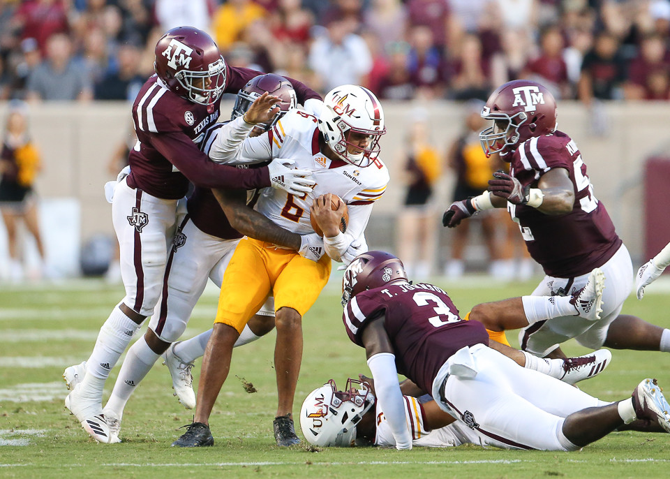 A group of Texas A&M Aggies defenders bring down Louisiana Monroe Warhawks quarterback Caleb Evans (6) during an NCAA football game between Texas A&M and ULM on Saturday, Sept. 15, 2018 in College Station, Texas.