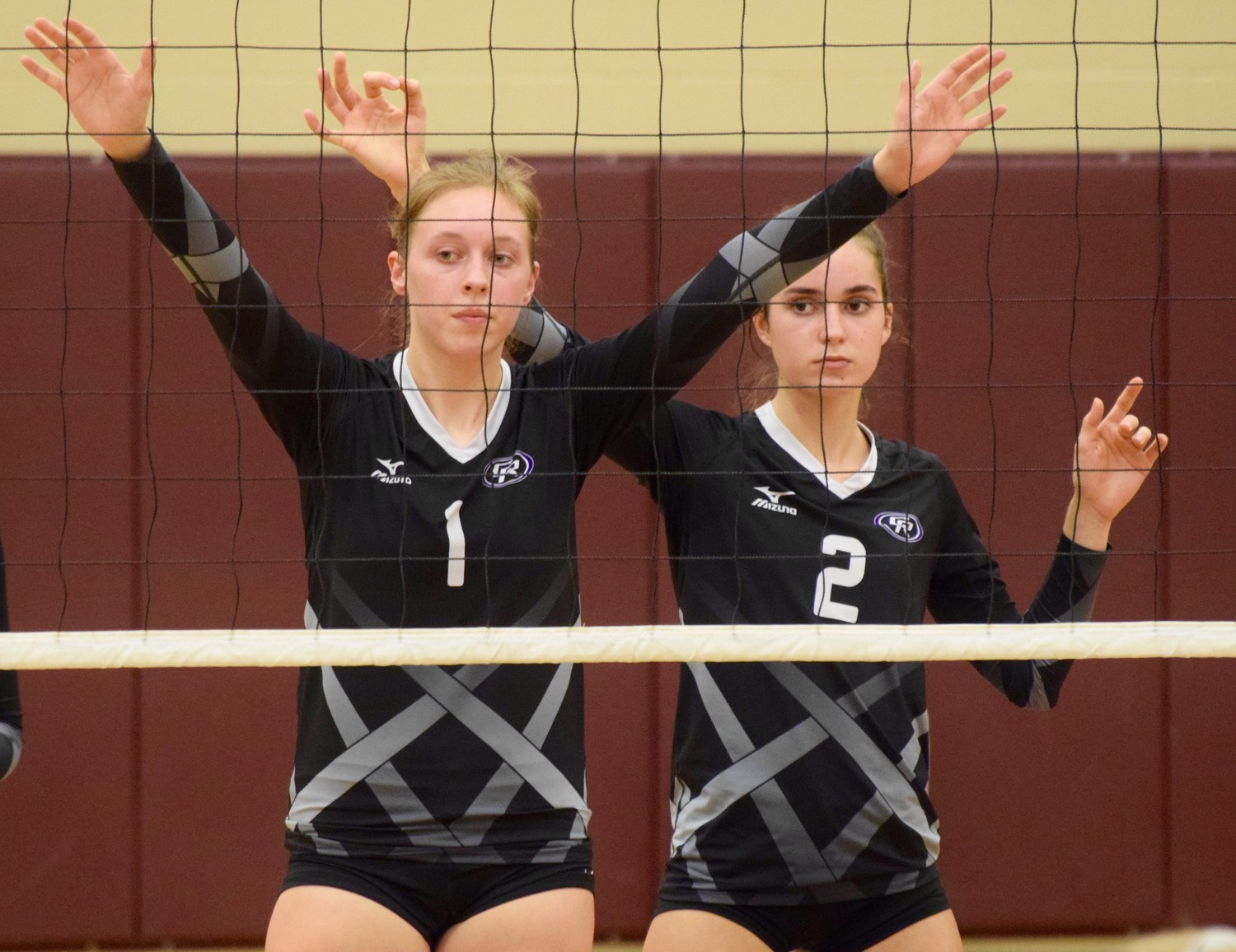 Andi Wagner, left, Lauren Prendeville and Cedar Ridge lost to Round Rock  3-0 (25-18, 25-22, 25-23) on Tuesday night.