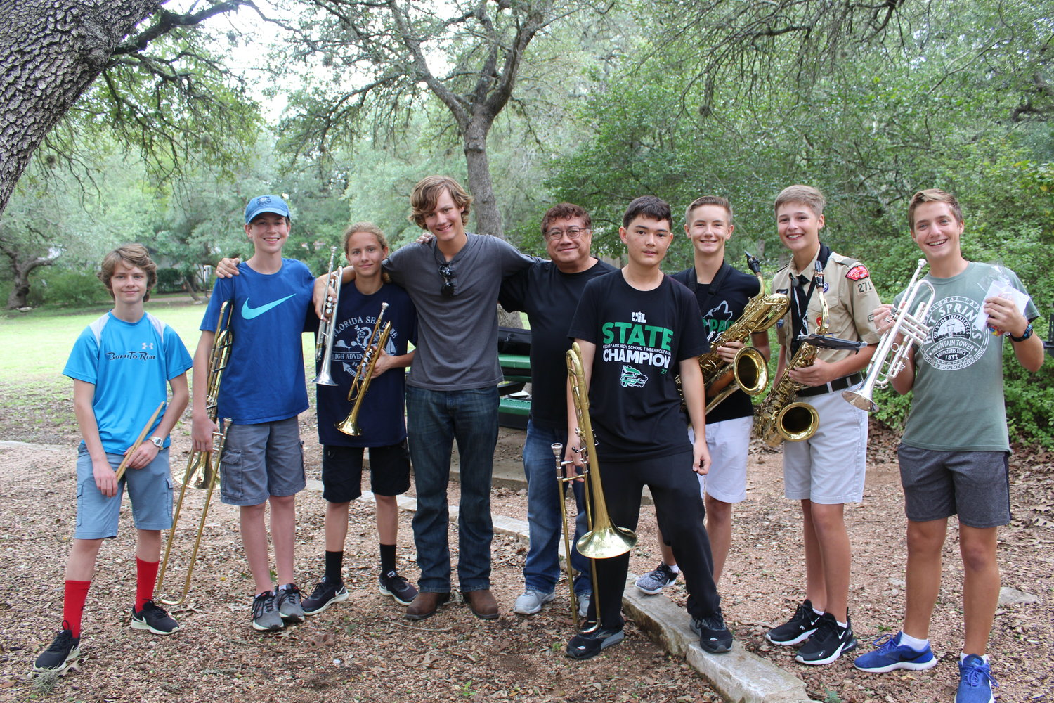 From left to right, Hunter Ryan, eighth grade CPMS percussion; Collin Borenstein, ninth grade CPHS trombone; Casey Ryan, ninth grade CPHS trumpet; Brendan Ryan, 12th grade CPHS trumpet; retired CPMS band director Manuel San Luis; Alex Mai, 10th grade CPHS trombone; Vladik Lebedev, 10th grade CPHS baritone sax; Will Lambert, 10th grade CPHS tenor sax; Davis Perron, 10th grade CPHS trumpet.
