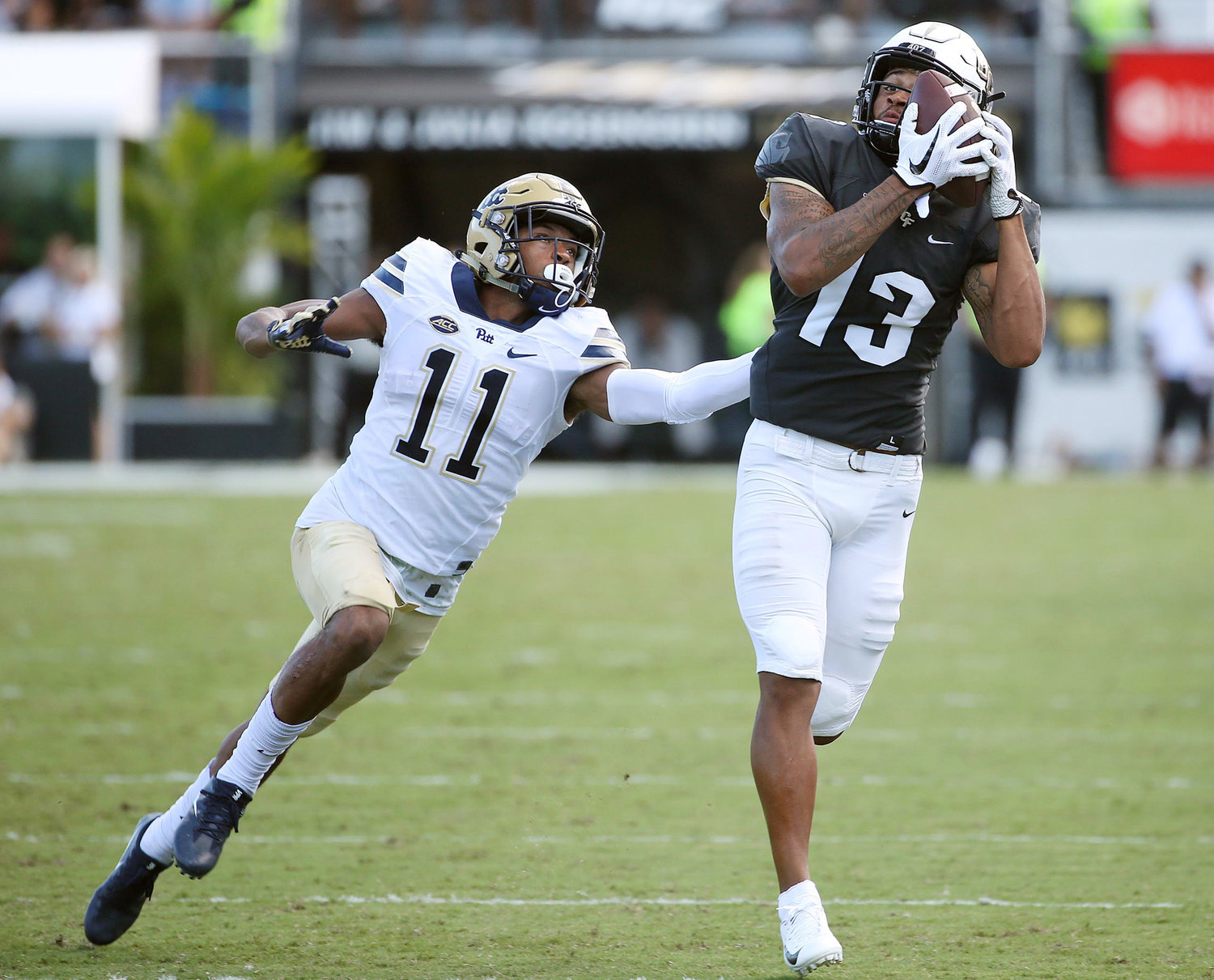 UCF wide receiver Gabriel Davis (13) catches a pass in front of Pitt defensive back Dane Jackson (11) at Spectrum Stadium in Orlando, Fla., on Saturday, Sept. 29, 2018. UCF won, 45-14.