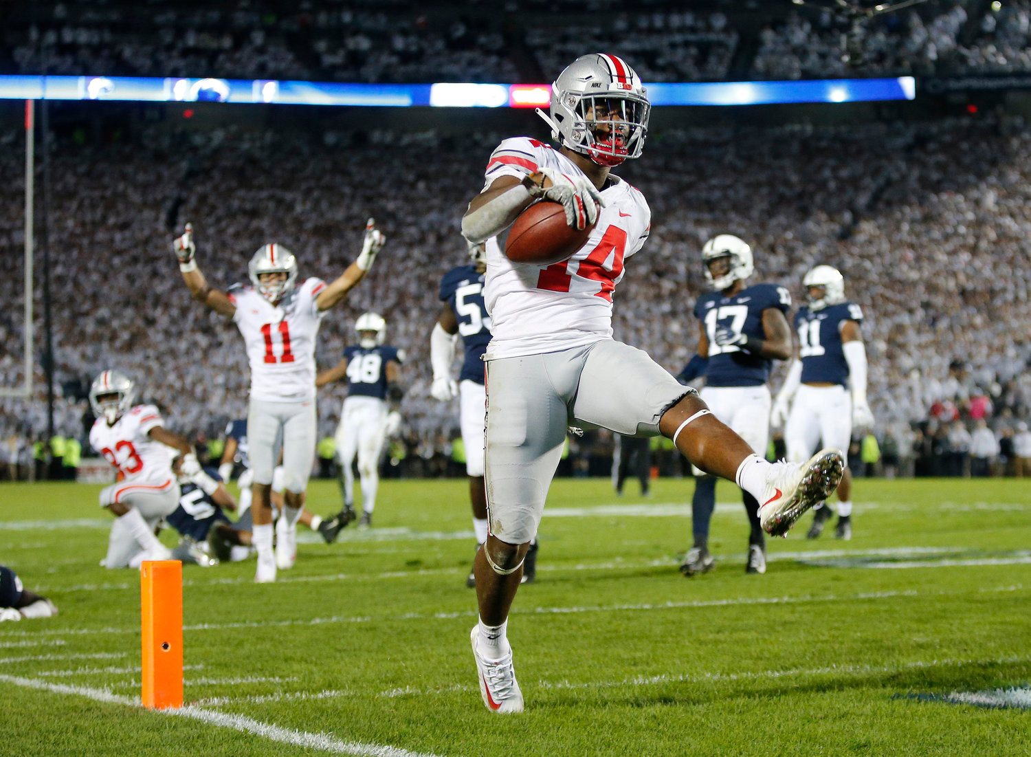 Ohio State wide receiver K.J. Hill Jr. (14) high-steps into the end zone for a 24-yard touchdown during the fourth quarter against Penn State at Beaver Stadium in University Park, Pa., on Saturday, Sept. 29, 2018. The visiting Buckeyes won, 27-26.
