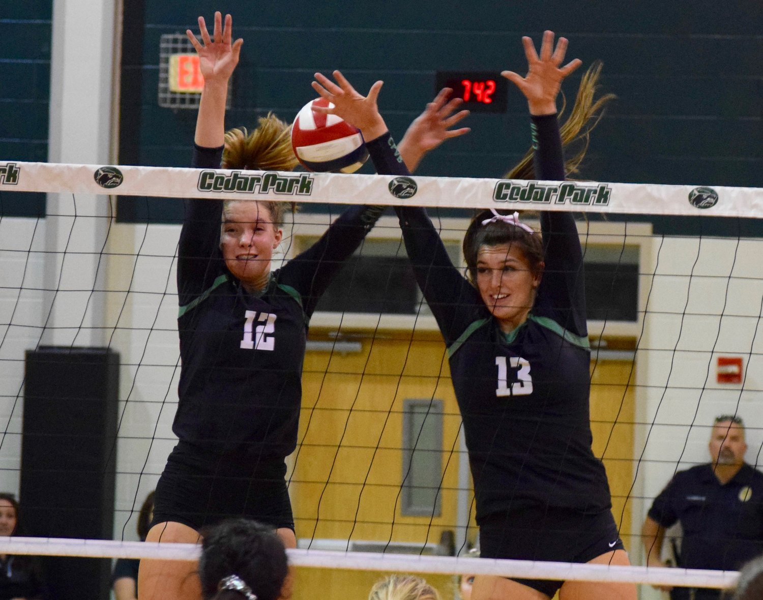 Olivia Meyer, left, Shelby Epley and Cedar Park swept Glenn 3-0 (25-16, 25-10, 25-14) Tuesday night in the first game of the second round of district play.