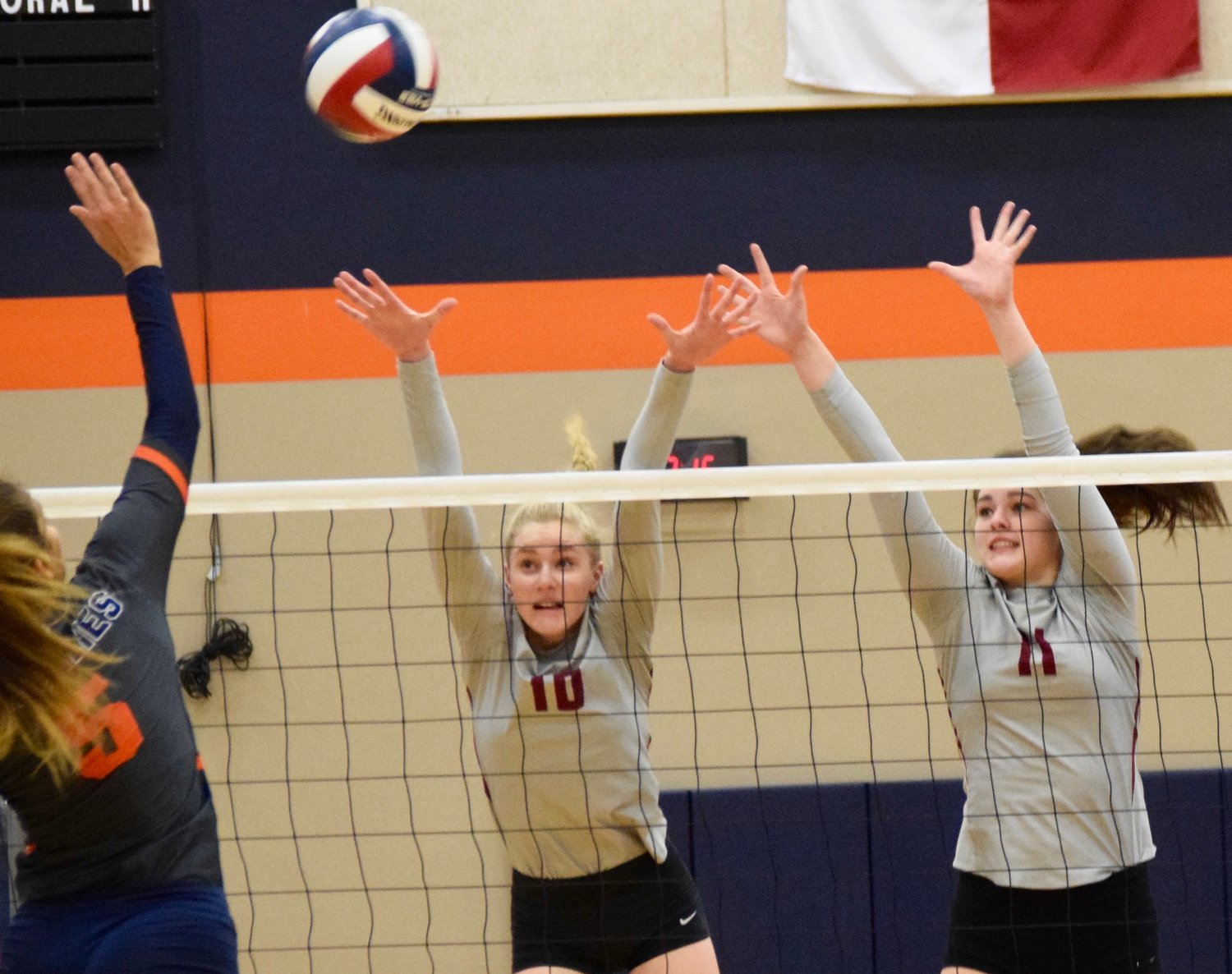 Kara Erfurth, left, MacKenzine Huntley and Rouse swept Glenn 3-0 (25-11, 25-10, 25-19) to stay undefeated in district play and push their winning streak to 10 games.