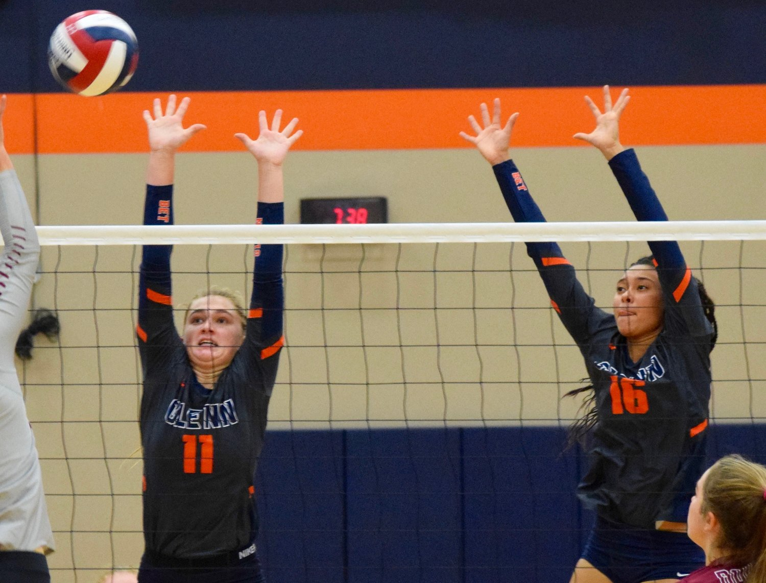 Emily Marchell, left, Chloe Coffee and Glenn were swept by Rouse 3-0 (25-11, 25-10, 25-19) Tuesday night at home.