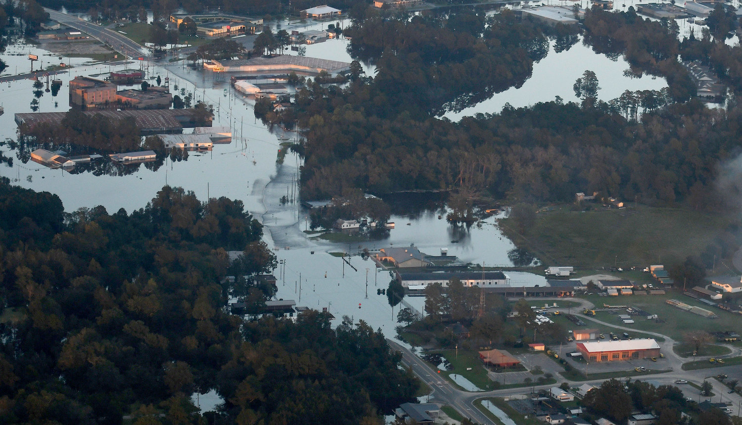 Areas of Kinston, N.C., remained under water late Friday, Sept. 21, 2018, as a result of Hurricane Florence. More than two weeks after Florence came ashore along the coast of North Carolina, the death toll from the storm continues to rise.