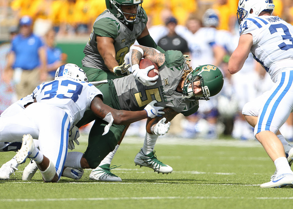 A group of Duke Blue Devils defenders bring down Baylor Bears wide receiver Jalen Hurd (5) during an NCAA football game between Baylor and Duke on Saturday, Sept. 15, 2018 in Waco Texas.