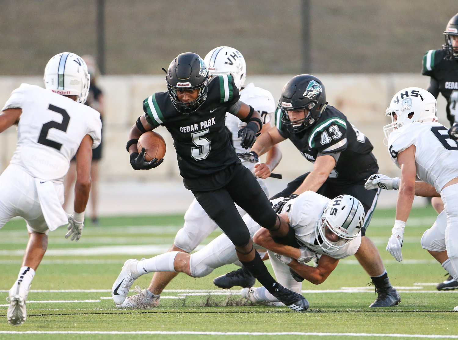 Cedar Park Timberwolves sophomore Kiyon King (5) carries the ball during a high school football game between the Cedar Park Timberwolves and the Vandegrift Vipers on Friday, Aug. 31, 2018 in Cedar Park, Texas.