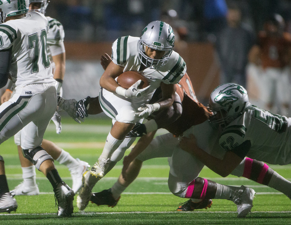 Cedar Park Timberwolves junior running back Jonathan Stockwell (16) carries the ball during a high school football game between Hutto and Cedar Park on Friday, Oct. 19, 2018 at Hippo Stadium in Hutto, Texas.