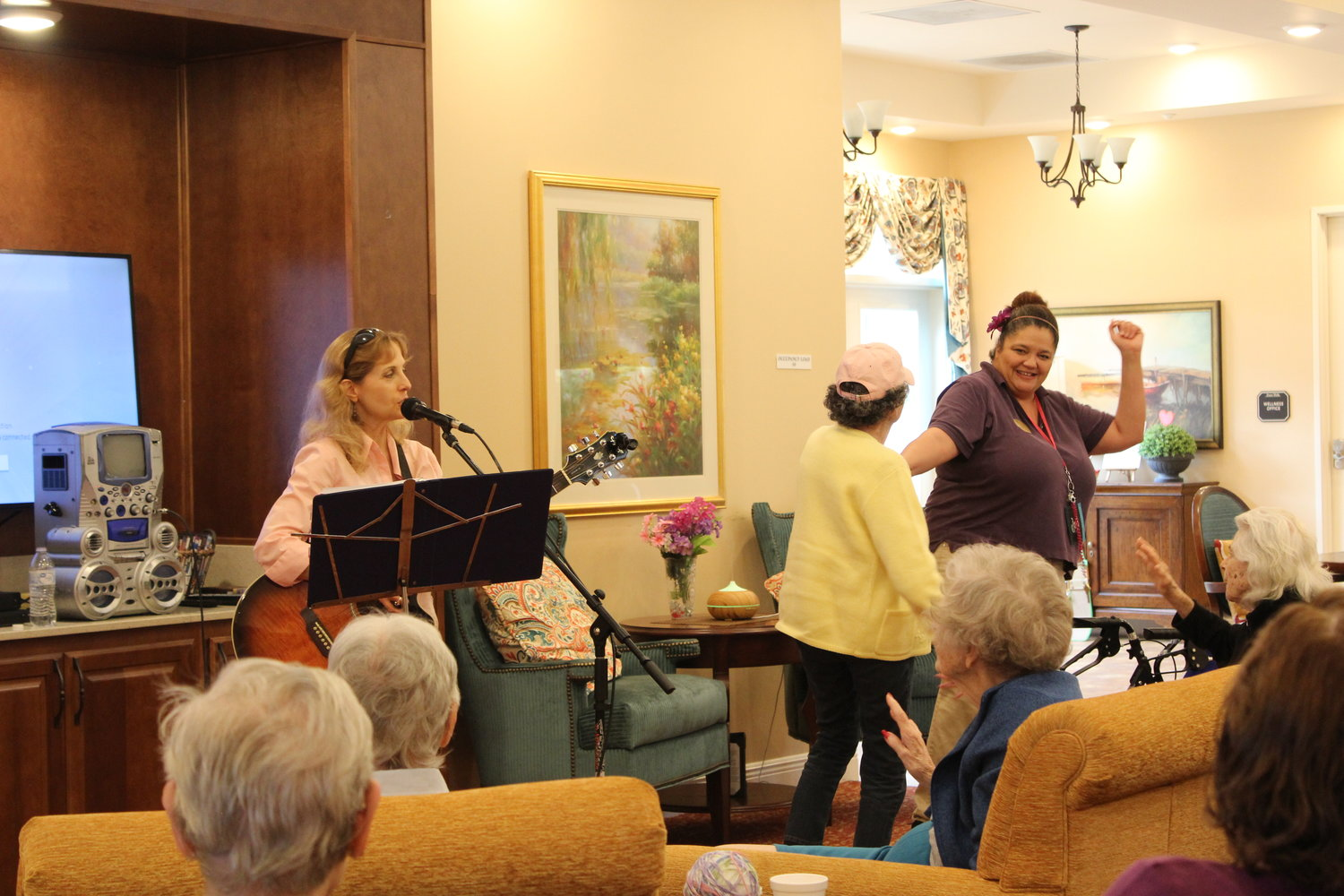 Visiting musician India Taylor performs for the residents of Poet's Walk Cedar Park, a local memory care facility, on Sept. 29.