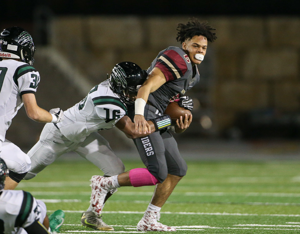 Rouse Raiders senior Tavian Tate (6) carries the ball after a tackle attempt by Connally Cougars junior Harrison McKinley (16) jarred his helmet loose during a high school football game between Rouse High School and Connally High School at Gupton Stadium in Cedar Park, Texas on Oct. 26, 2018.