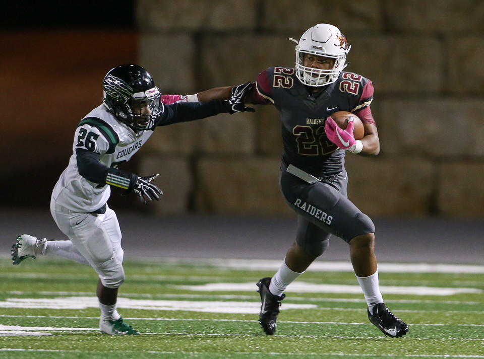 Rouse Raiders junior running back Mylan Mitchell (22) carries the ball during a high school football game between Rouse High School and Connally High School at Gupton Stadium in Cedar Park, Texas on Oct. 26, 2018.