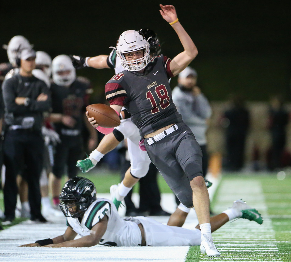 Rouse Raiders senior quarterback Ethan Moore (18) runs down the sideline during a high school football game between Rouse High School and Connally High School at Gupton Stadium in Cedar Park, Texas on Oct. 26, 2018.