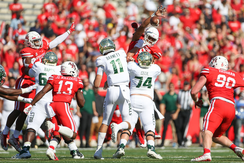 Houston Cougars defensive lineman Payton Turner (98) knocks down a pass during a college football game the University of Houston and the University of South Florida on Saturday, Oct. 27, 2018 at TDECU Stadium in Houston, Texas. Houston won, 57-36.