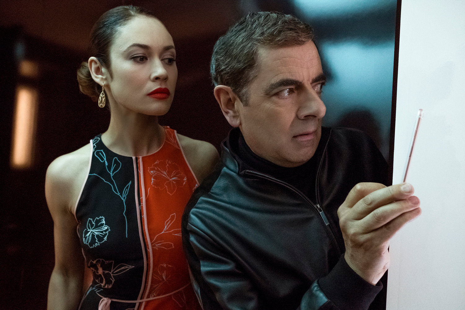 "Olga Kurylenko and Rowan Atkinson star in ""Johnny English Strikes Again."""