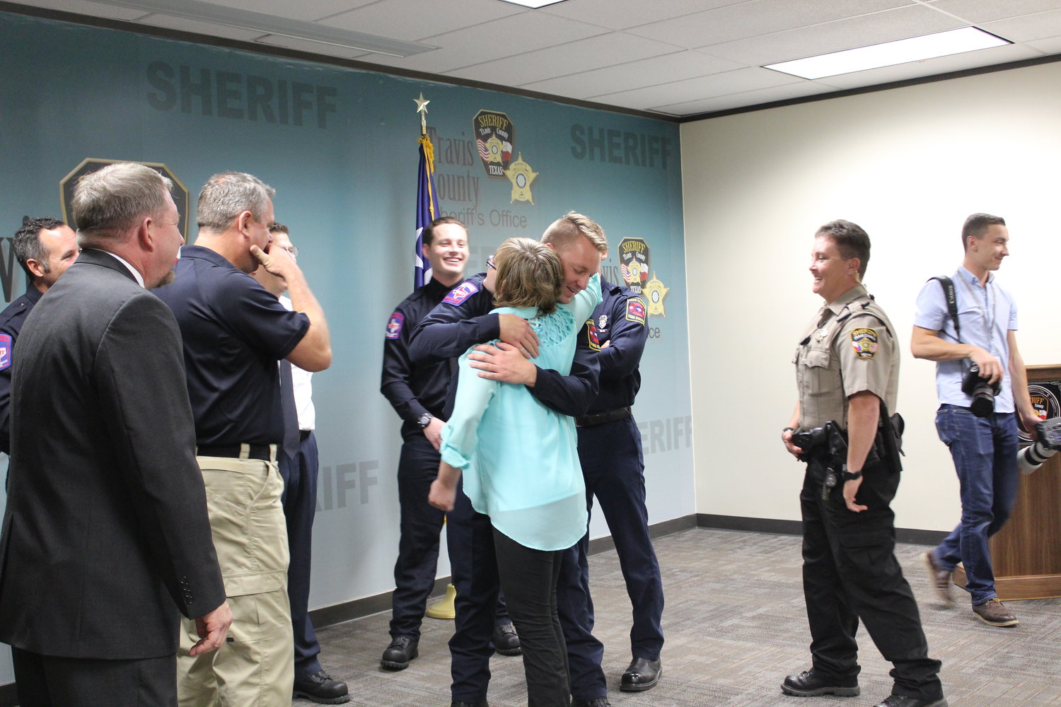 Jaclyn Burden shares a hug with one of the first responders who saved her life on March 15, 2017, after she was shot in the head and arm in a double-homicide that took the life of her boyfriend and her landlord.