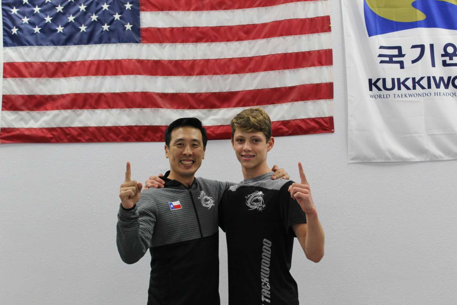 Zachary Hampton (right) stands with his instructor Master Hyun Kim at HK Taekwondo in Cedar Park. Hampton recently earned a gold medal at the President's Cup in Las Vegas.