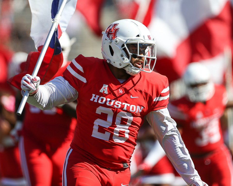 Houston Cougars running back Josh Burrell (28) carries the Texas flag onto the before the start of a college football game the University of Houston and the University of South Florida on Saturday, Oct. 27, 2018 at TDECU Stadium in Houston, Texas. Houston won, 57-36.