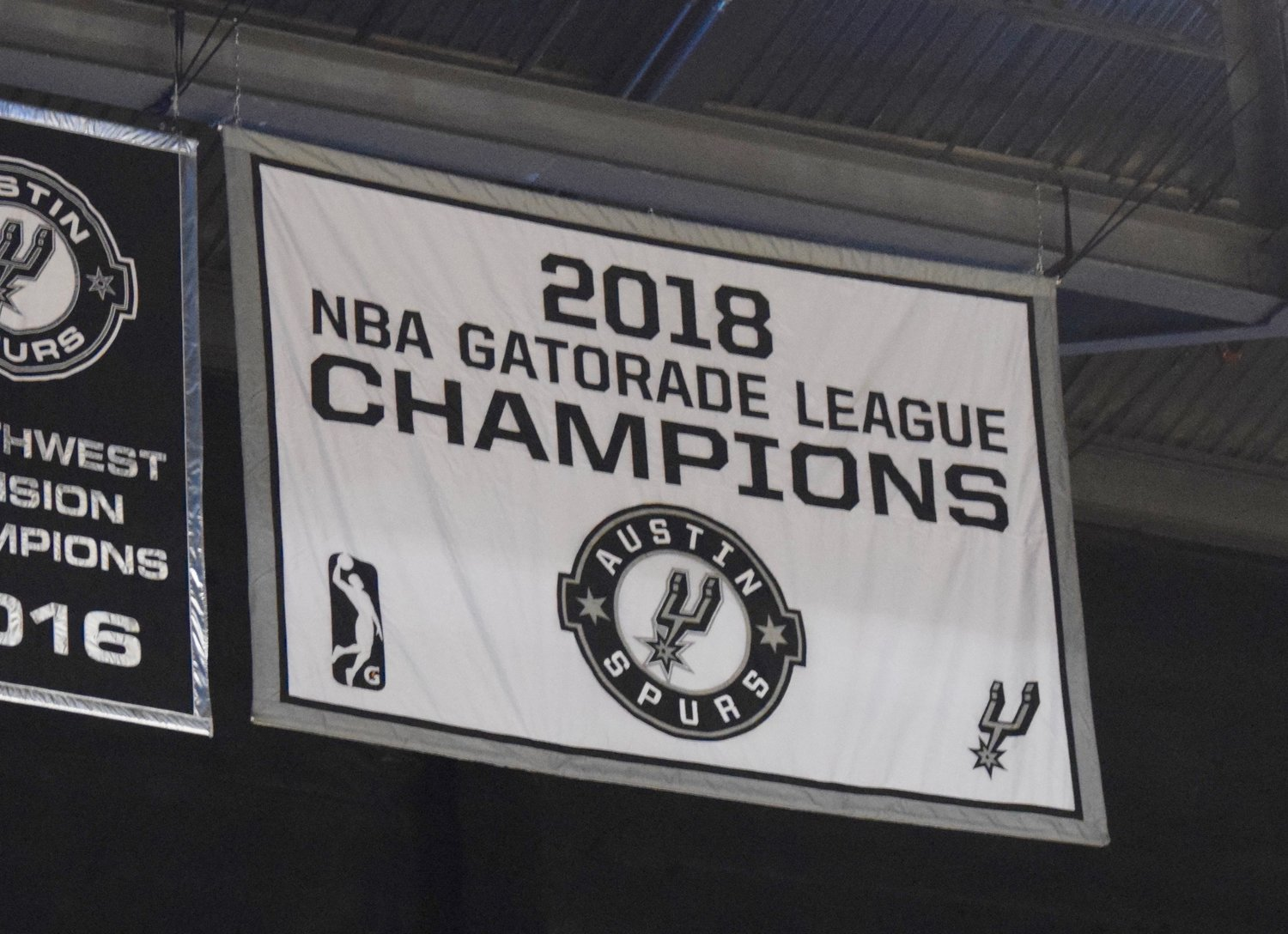 The Austin Spurs raised their second championship banner to the rafters of the HEB Center on Saturday night but lost to the Texas Legends 126-120.