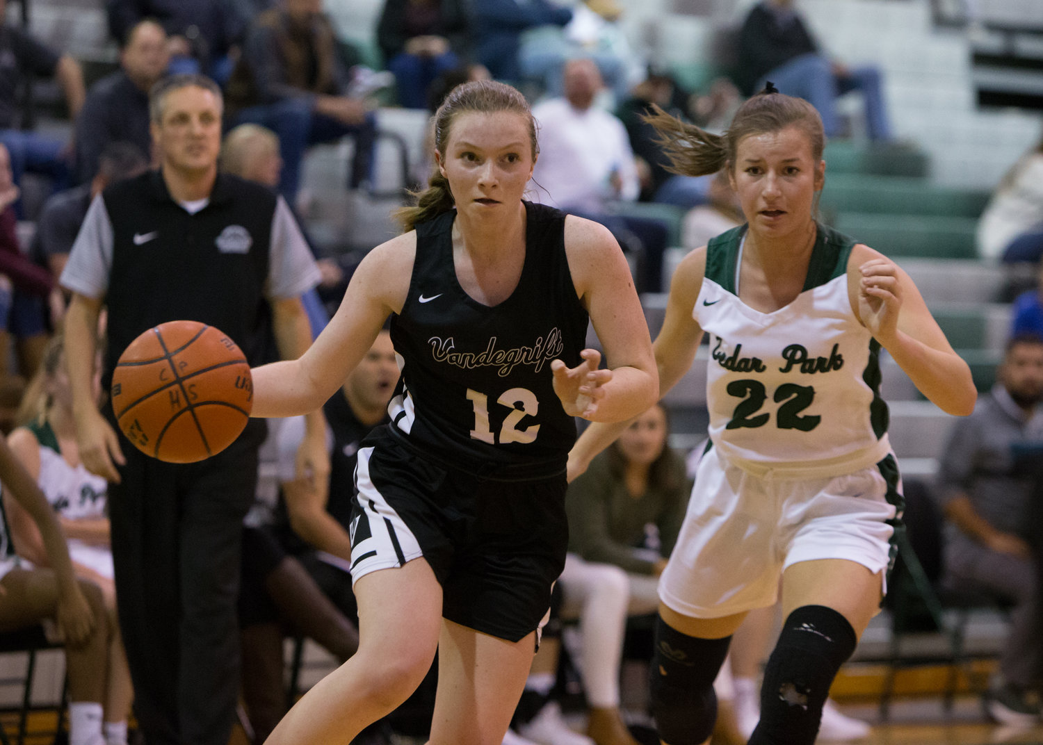 Vandegrift Vipers guard Jen Moore (12) moves the ball during a high school girls basketball game between Cedar Park and Vandegrift at Cedar Park High School on Tuesday, Nov. 13, 2018 in Cedar Park, TX.