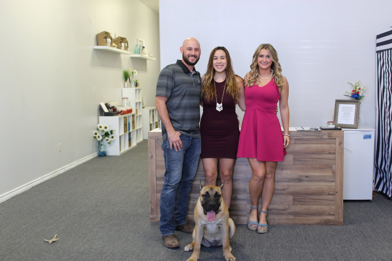 Owners Justin Gustovich and Anna Silvaand marketing and event coordinator Brooks Roach (L-R) stand in their Buck to Basics yoga studio space in Leander.
