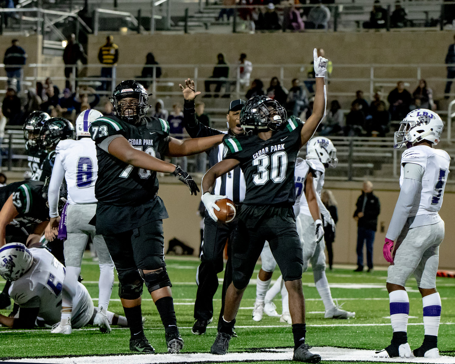 Javion Mays, right, scored Cedar Park's only touchdown in its win against Austin LBJ last Friday. The Timberwolves take on undefeated Shadow Creek in the second round.