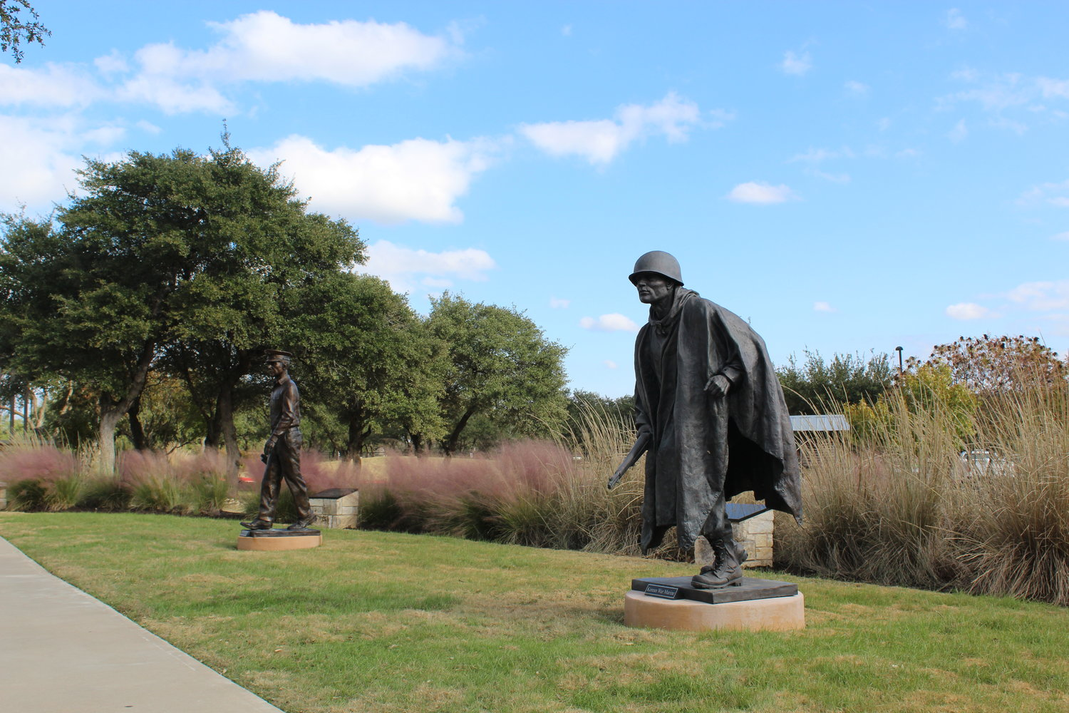 Cedar Park's Veterans Memorial Park currently features three military figures: a World War I soldier (not pictured), a World War II soldier (left) and a Korean War soldier (right).