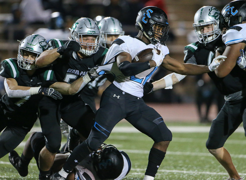 The Cedar Park Timberwolves defense works to corral Shadow Creek Sharks running back Marquez Huland (22) during a high school football playoff game between Cedar Park and Shadow Creek at Merrill Green Stadium on Friday, Nov. 23, 2018 in Bryan, TX.