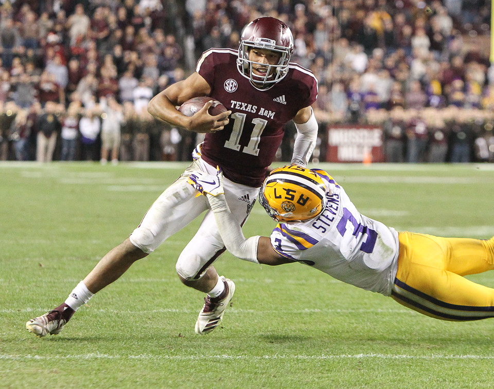 Texas A&M Aggies quarterback Kellen Mond (11) is brought down by LSU Tigers safety JaCoby Stevens (3) on a carry during the first overtime period of an NCAA college football game between Texas A&M and LSU at Kyle Field on Saturday, Nov. 24, 2018 in College Station, TX.