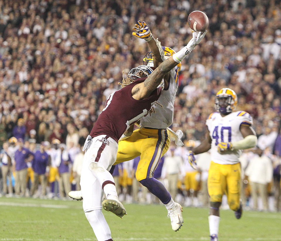 Texas A&M Aggies wide receiver Kendrick Rogers brings in an acrobatic reception for a touchdown during the third overtime period of an NCAA college football game between Texas A&M and LSU at Kyle Field on Saturday Nov. 24 2018 in College Station T
