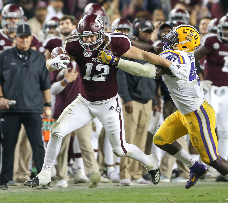 Texas A&M Aggies fullback Cullen Gillaspia (12) tries to escape the grasp of LSU Tigers linebacker Devin White (40) after catching a pass during an NCAA college football game between Texas A&M and LSU at Kyle Field on Saturday, Nov. 24, 2018 in College Station, TX.