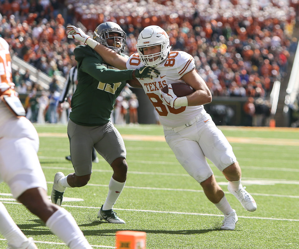 Texas Longhorns tight end Cade Brewer (80) carries the ball during the third quarter of a college football game between the Baylor Bears and the Texas Longhorns at McLane Stadium in Waco, Texas.