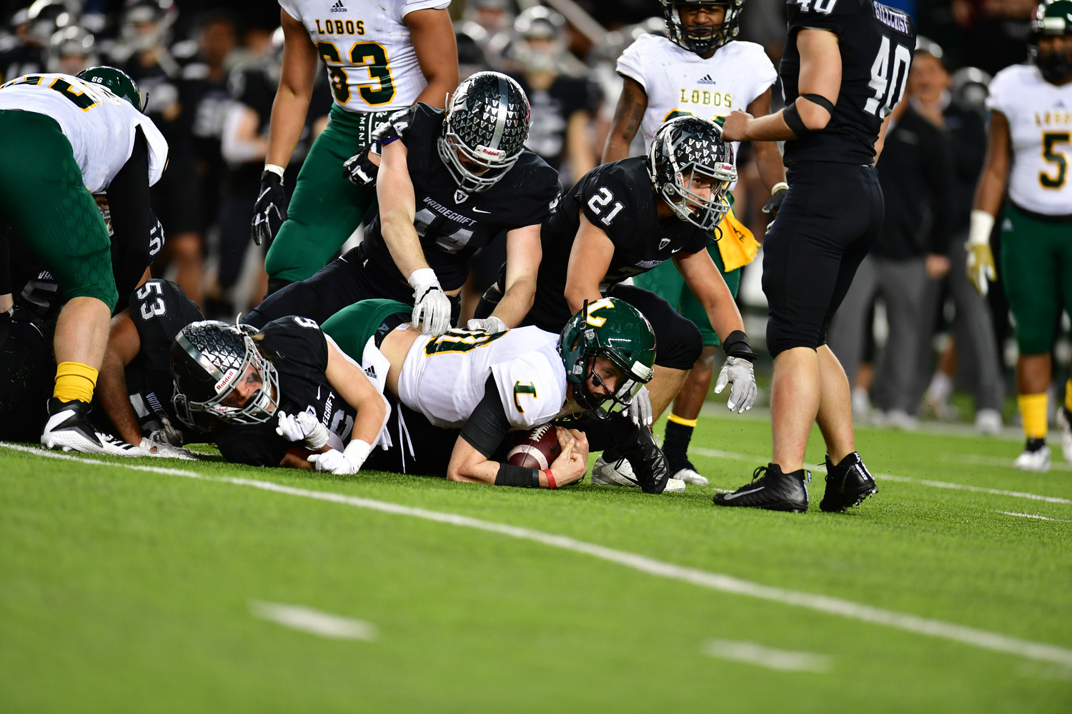 Trevor Harrison, left, Jax McCauley and Vandegrift fell to Longview 56-28 in the regional semifinals Saturday at McLane Stadium in Waco.