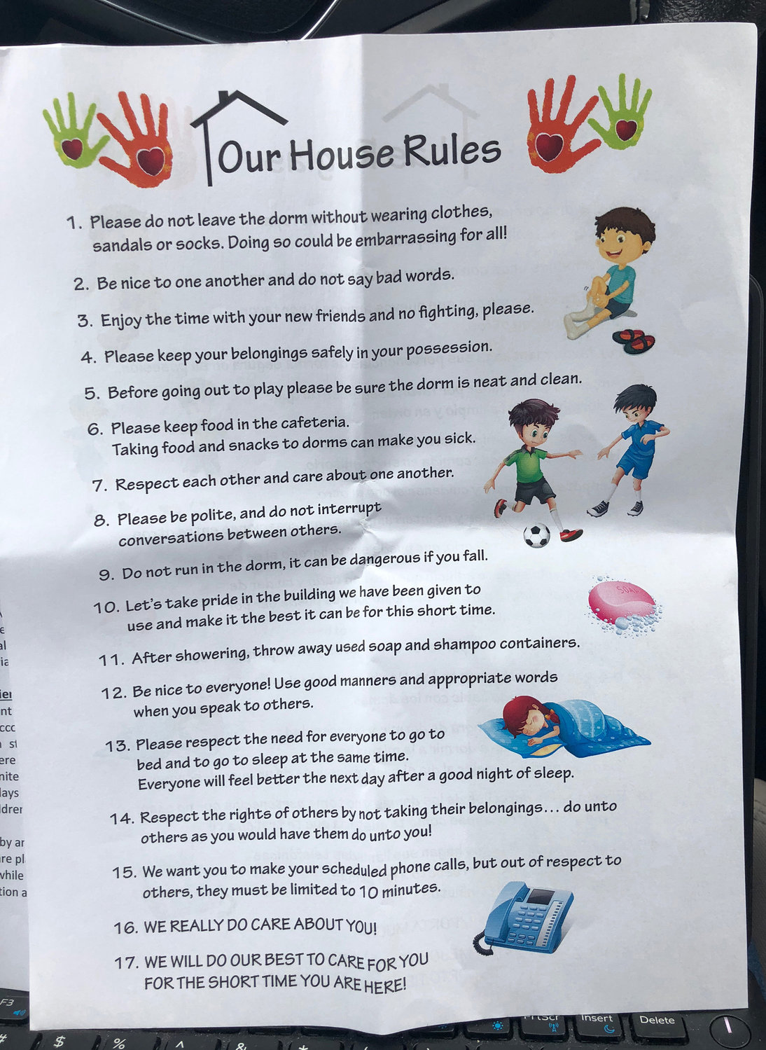 "A photograph of the ""House Rules"" for children detained in the immigration detention center in Tornillo, Texas."