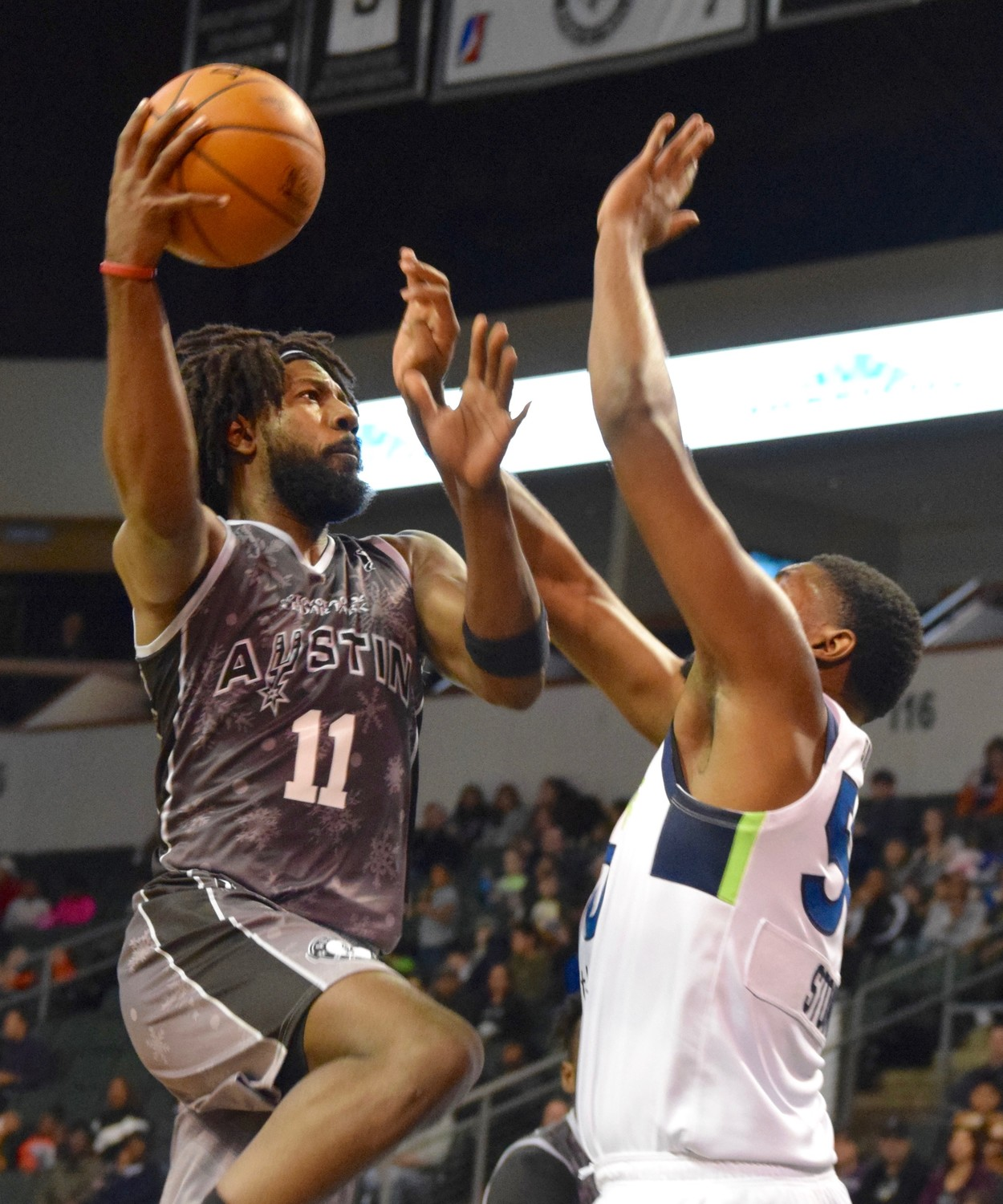 John Holland scored 12 points and the Austin Spurs beat the Iowa Wolves 118-116 on Saturday night.