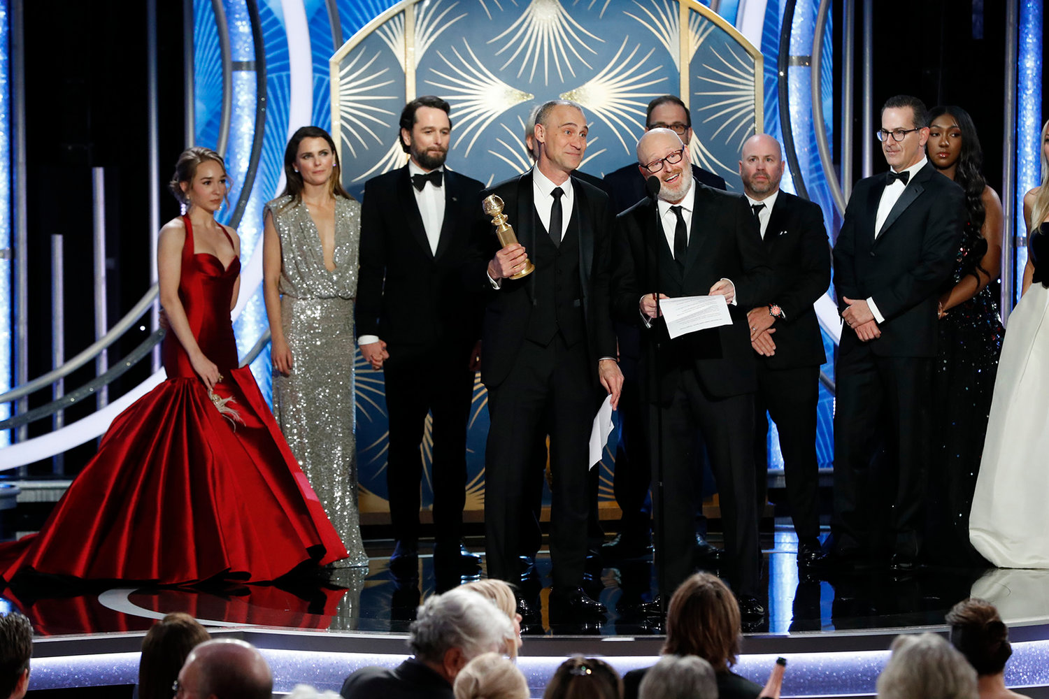 "In this handout photo provided by NBCUniversal, Joe Weinberg, right, from ""The Americans"" accepts the Best Television Series - Drama award onstage during the 76th Annual Golden Globe Awards at The Beverly Hilton Hotel on Sunday, Jan. 6, 2019 in Beverly Hills, Calif. (Paul Drinkwater/NBCUniversal/Getty Images/TNS)