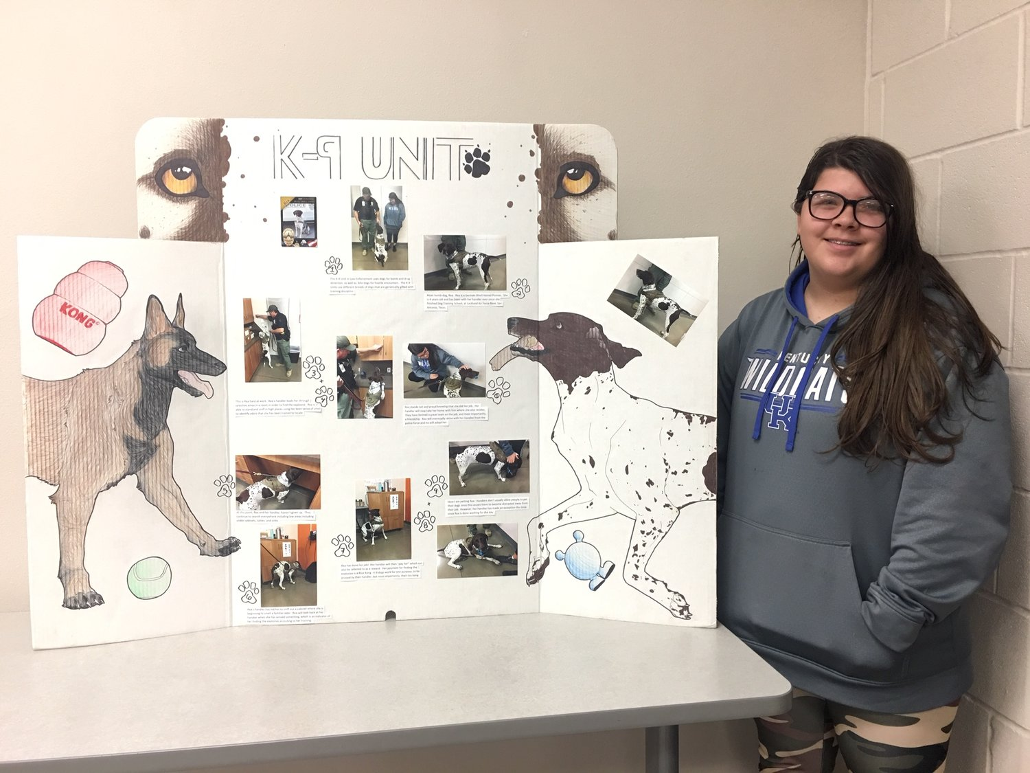 Elayna Combs poses with her entry in the Criminal Justice Display Panel competition at the District 10 SkillsUSA competition.