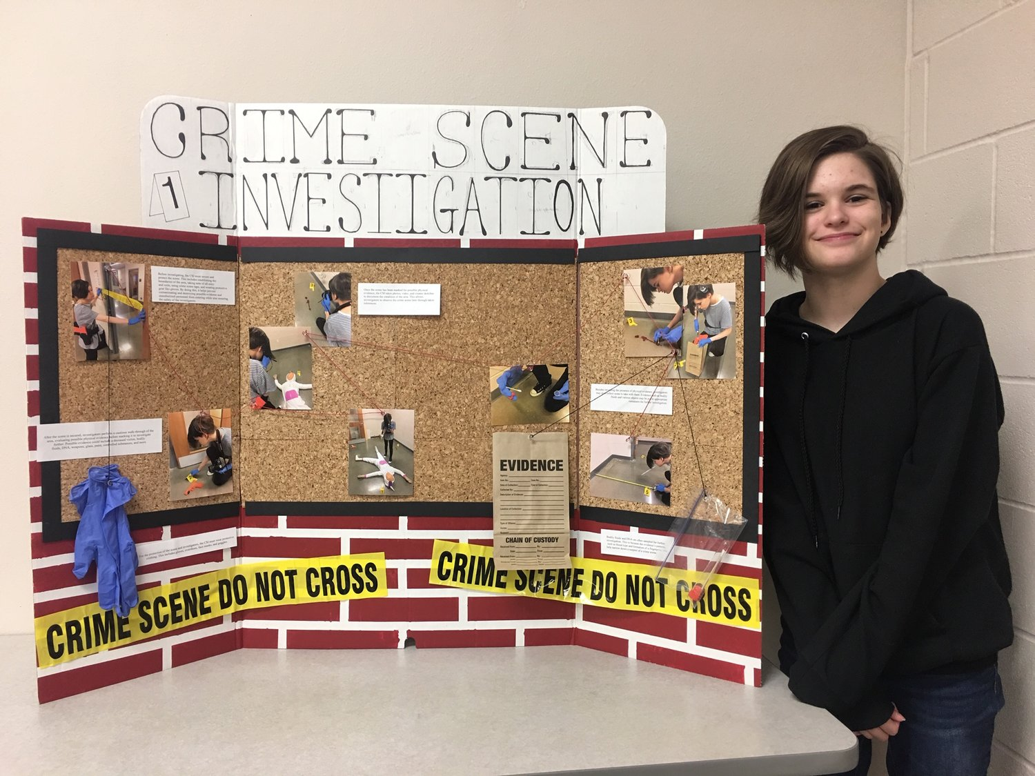 Katherine Law poses with her entry in the Criminal Justice Display Panel competition at the District 10 SkillsUSA competition.