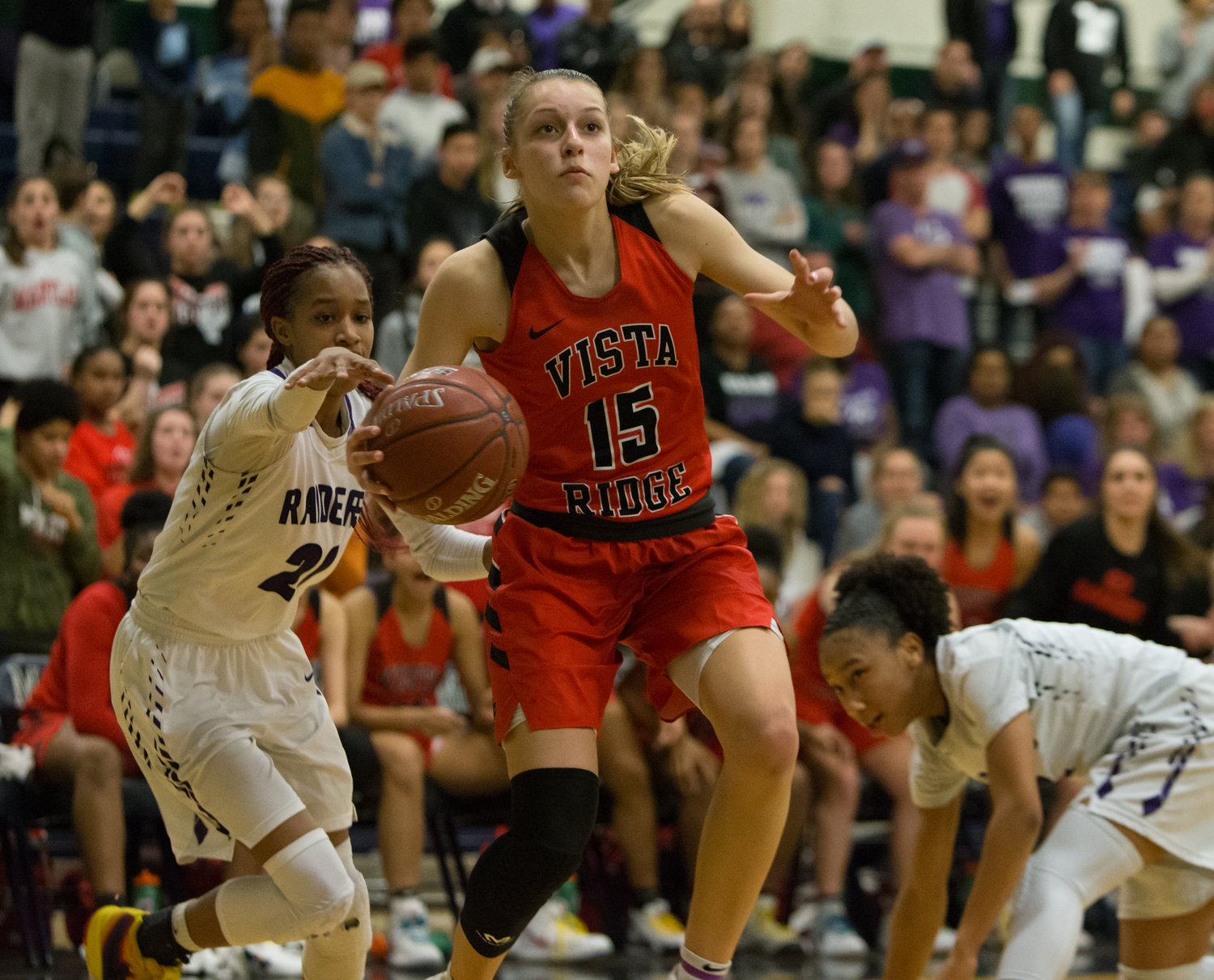 Vista Ridge Rangers sophomore guard Aj Marotte (15) moves the ball during a regional quarterfinal playoff girls basketball game between Vista Ridge and Cedar Ridge on Tuesday, Feb. 19, 2019 in Austin, Texas.