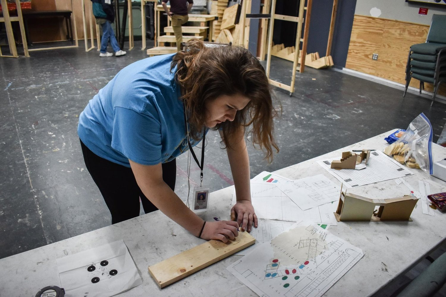 Vista Ridge High School senior Victoria Vives works on plans for a building project at Georgetown Palace Theater, during Leander ISD's COOL Week program.