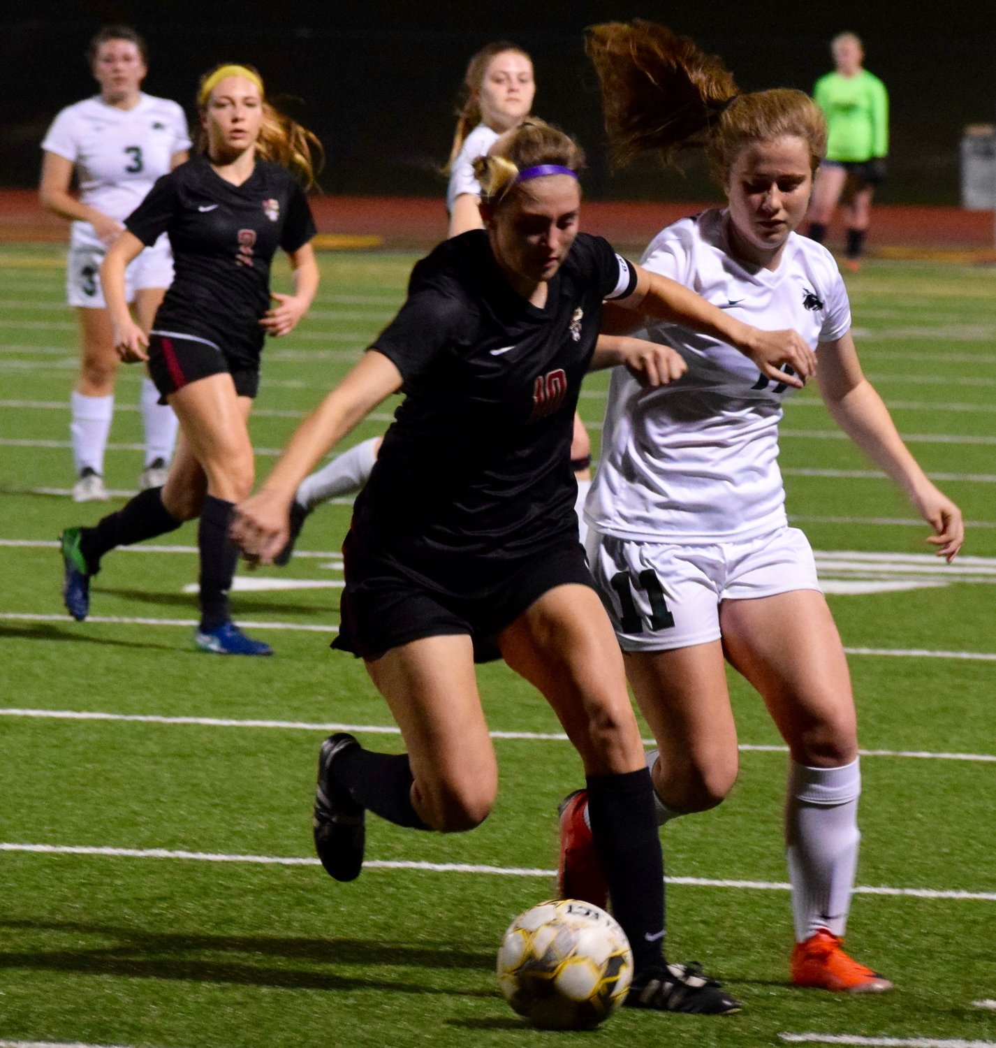 Megan Olds, left, and Rouse lost to Cedar Park 4-1 on Friday night.