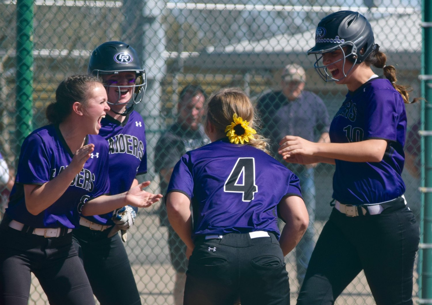 Stephie Elliott, right, celebrates with the rest oft eh Cedar Ridge team after hitting a grand slam to help the Lady Raiders beat Vista Ridge 9-2 on Saturday afternoon.