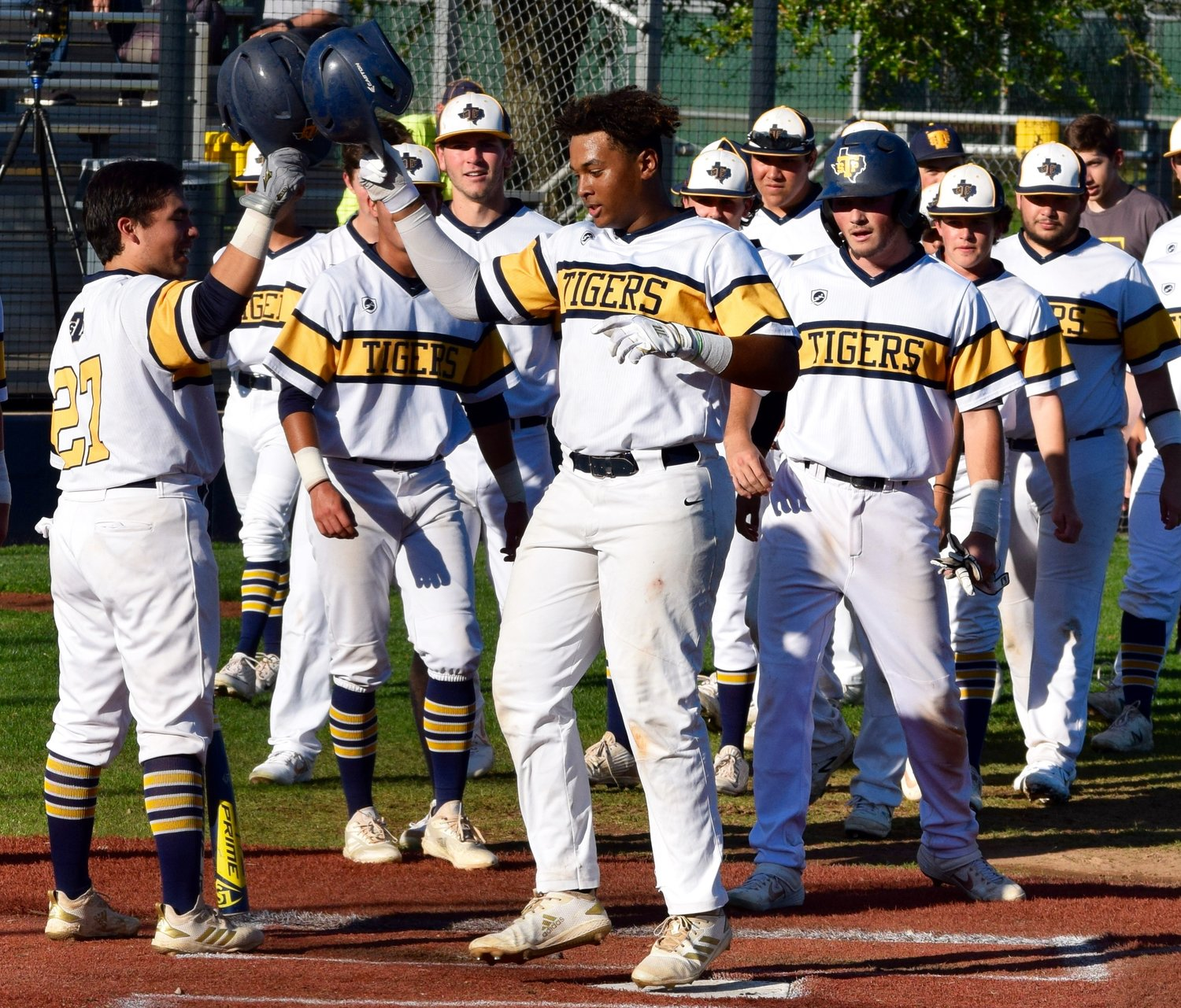 Kam Kelton, center, hit a 2-run home run and Stony Point beat Round Rock 8-3 at home on Monday afternoon. It was the first loss of the district season for the Dragons.