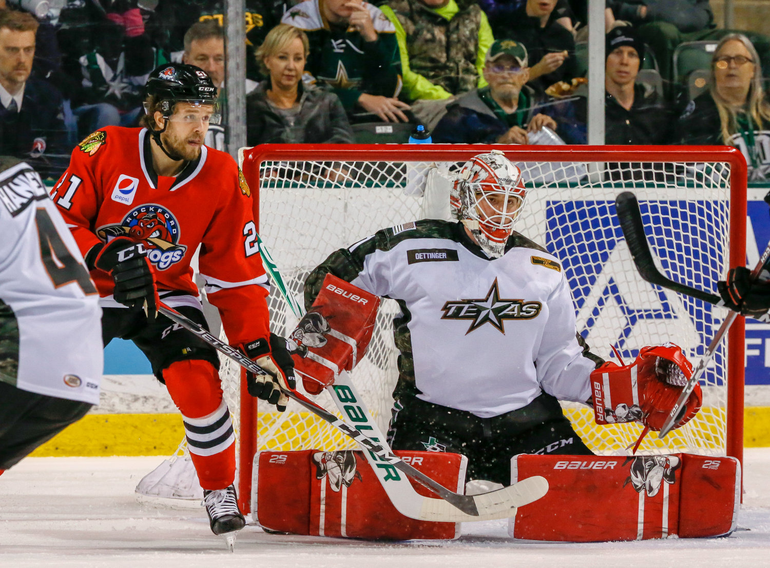 Jake Oettinger made 23 saves in his first start at the HEB Center in the Stars' 2-1 shootout win over the IceHogs on Friday night. Texas is on the outside of the playoffs looking in with three games left in the regular season.
