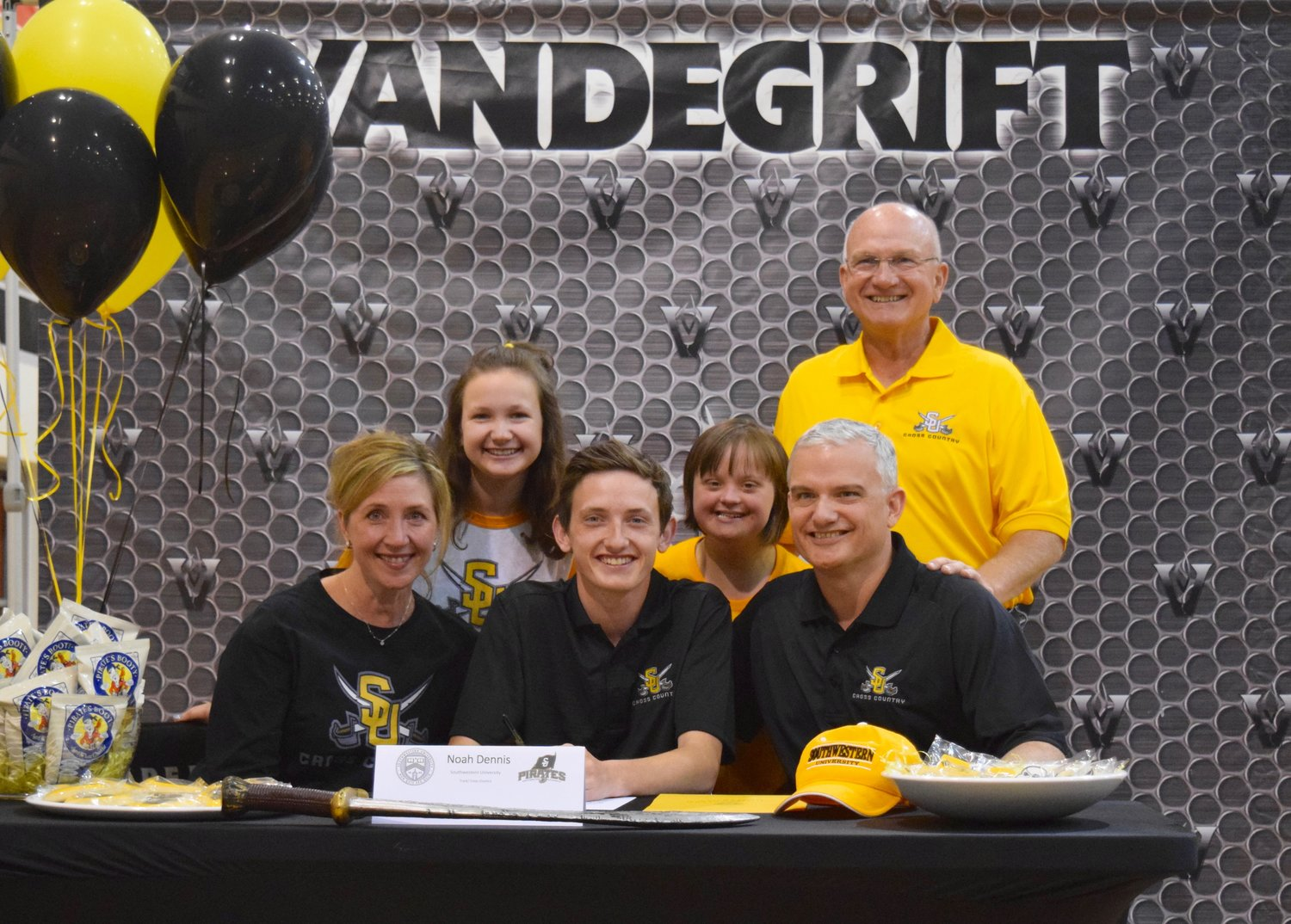 Noah Dennis signed on to run cross country/track at Southwestern University at a signing day celebration Friday morning at Vandegrift High School.