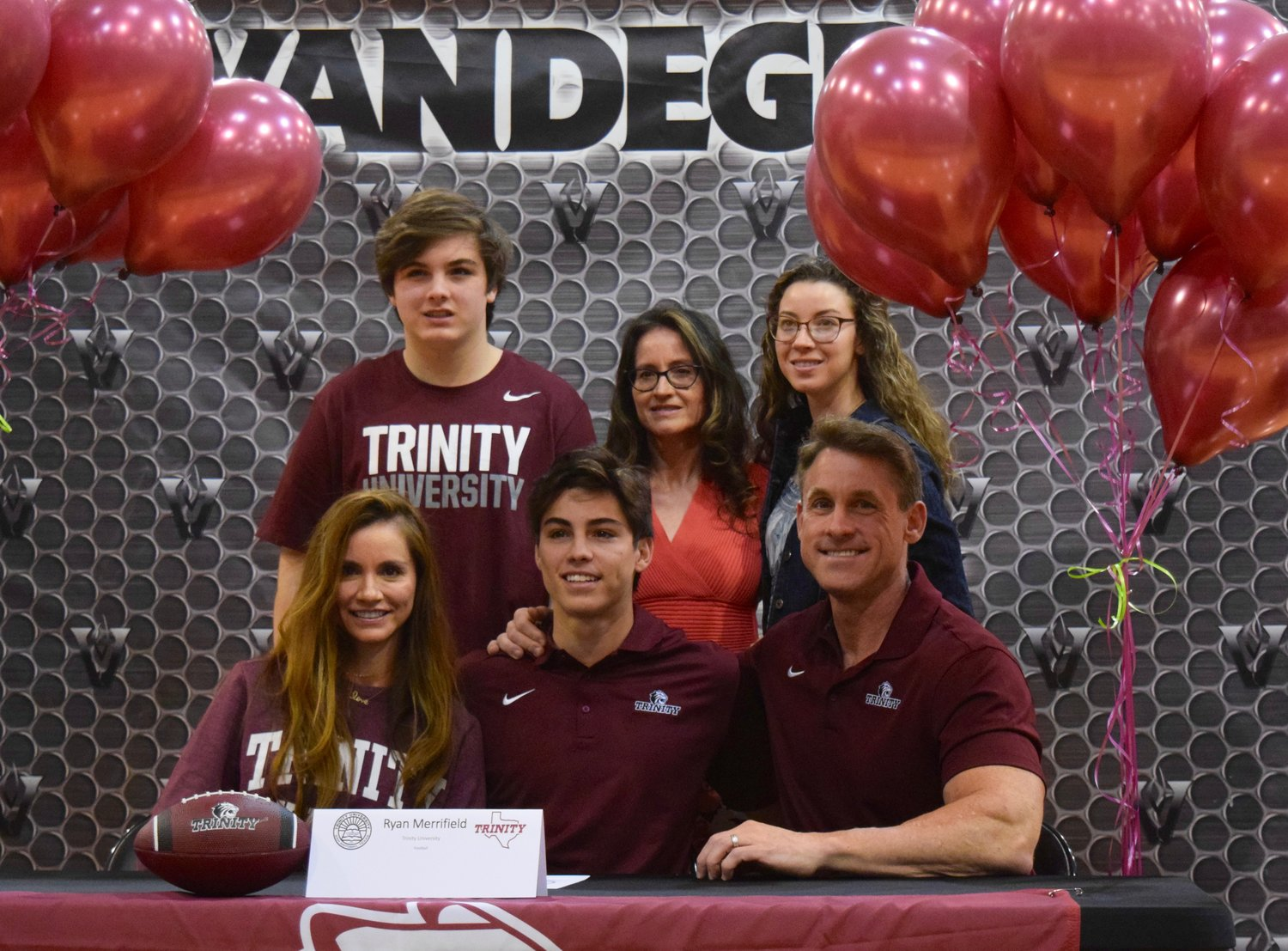 Ryan Merrifield signed on to play football at Trinity at a signing day celebration Friday morning at Vandegrift High School.